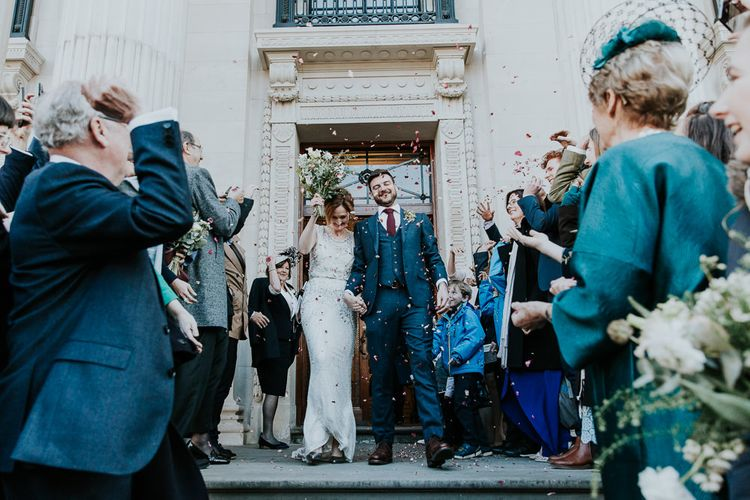 Confetti Exit | Bride in Jenny Packham Esme Gown | Groom in Navy Ted Baker Suit | Navy & Silver Winter Wedding in London | Joasis Photography