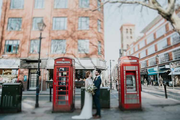 Red Telephone Boxes | Bride in Jenny Packham Esme Gown | Groom in Navy Ted Baker Suit | Navy & Silver Winter Wedding in London | Joasis Photography