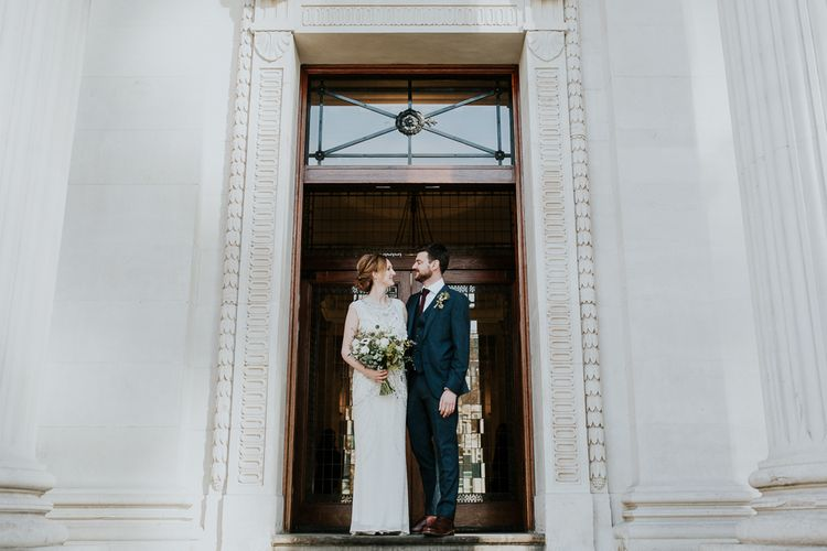 Bride in Jenny Packham Esme Gown | Groom in Navy Ted Baker Suit | Navy & Silver Winter Wedding in London | Joasis Photography