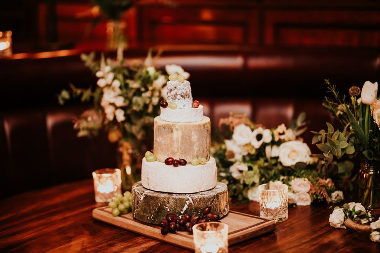 Neal's Yard Cheese Tower Wedding Cake | Navy & Silver Winter Wedding Reception at Hawksmoor Guildhall in London | Joasis Photography