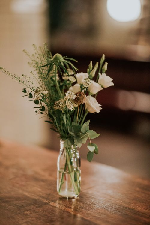 White Flower Stems in Jars | Navy & Silver Winter Wedding Reception at Hawksmoor Guildhall in London | Joasis Photography