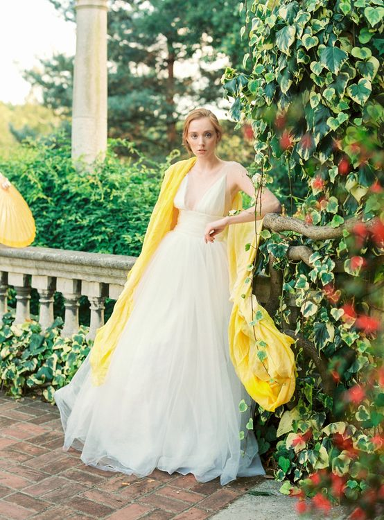 Bride in Tulle Wedding Dress with Yellow Pashmina Cover Up