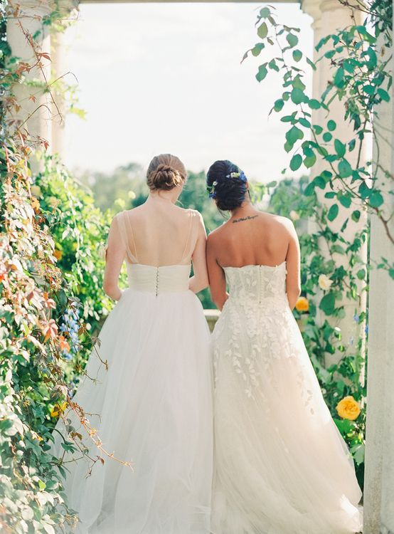 Same Sex Bridal Couple in Tulle and Applique Wedding Dresses