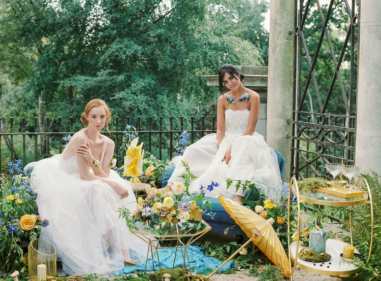 Two Brides with Yellow and Blue Flowers and Gold Geometric Details