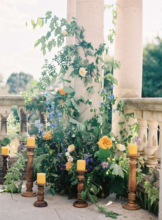Yellow and Blue Wedding Flowers with Yellow Candles