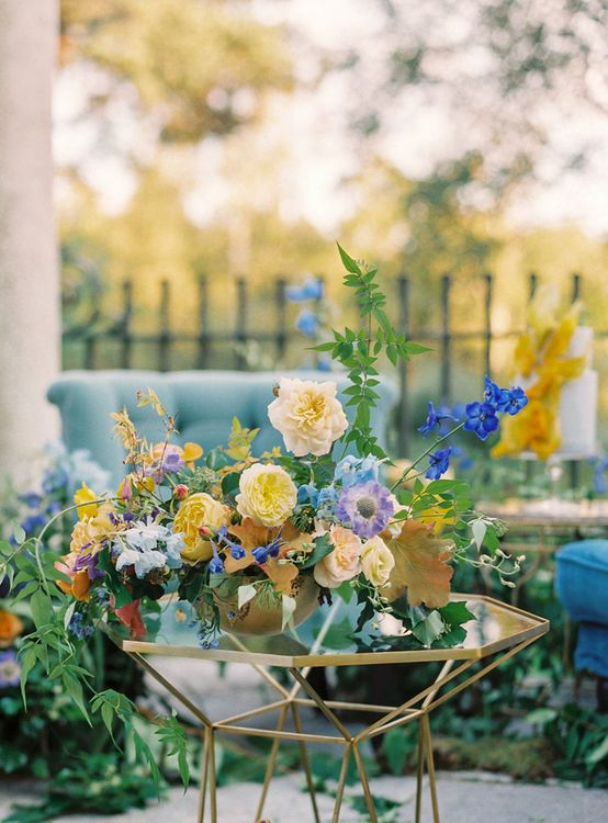 Yellow and Blue Wedding Floral Arrangement on Gold Geometric Table