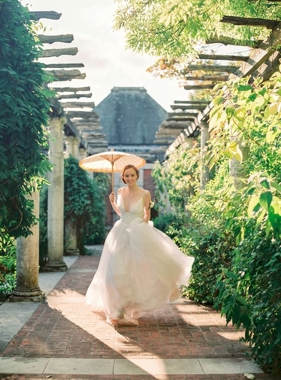 Beautiful Bride in Tulle Wedding Dress with Yellow Parasol