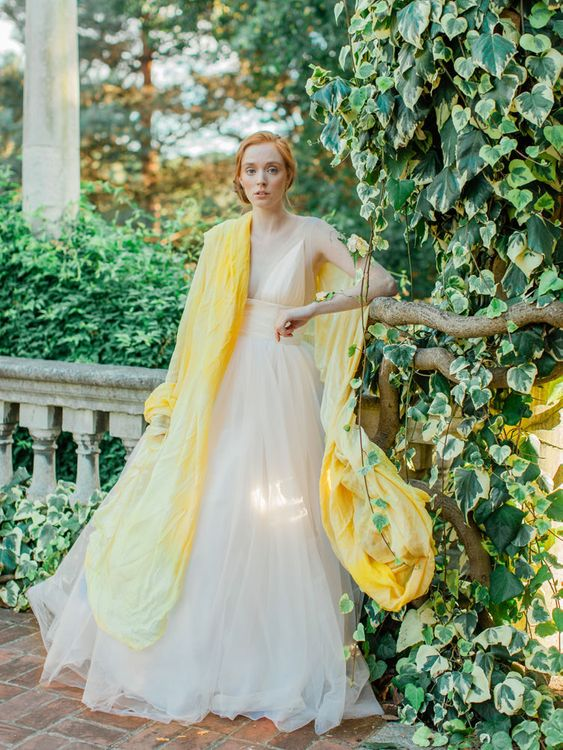 Bride in Tulle Wedding Dress with Yellow Pashmina Wrap