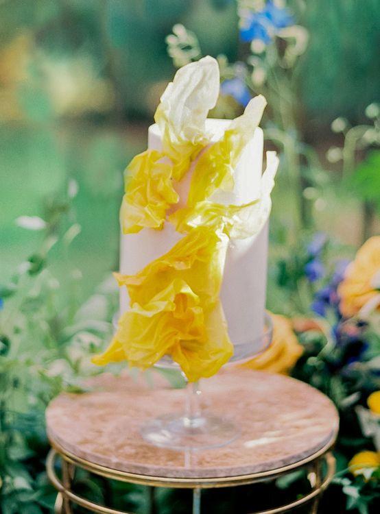 Two Tier White Wedding Cake with Yellow Wedding Decor