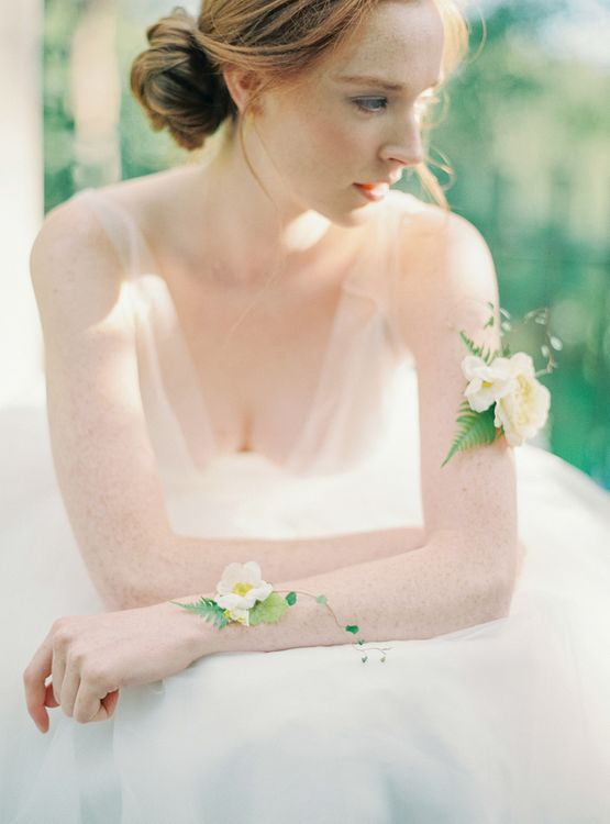 Bride in Tulle Wedding Dress with Wrist and Bicep Corsages
