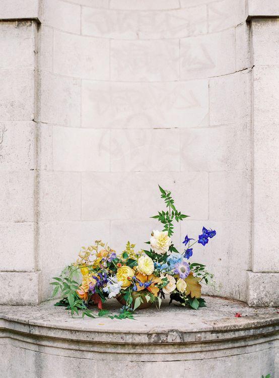 Yellow, Blue and Foliage Wedding Flower Arrangement