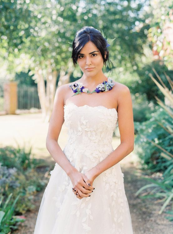 Bride in Strapless Applique Gown with Blue Flower Collar