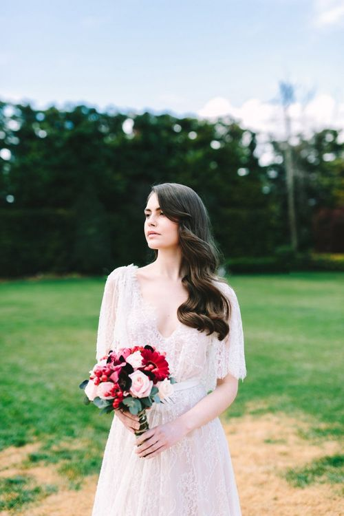 Bride in Lace Wedding Dress with Finger Waves and Red Wedding Bouquet