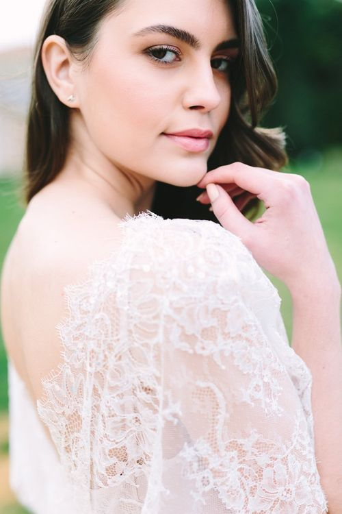 Bride with Natural Makeup Wearing a Lace Wedding Dress