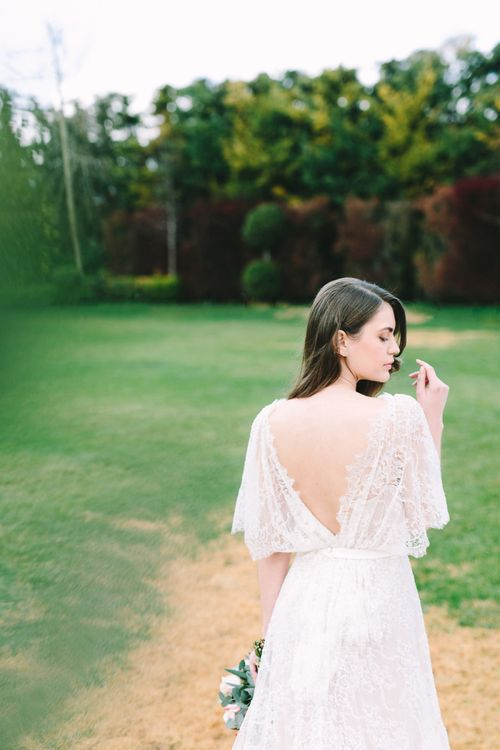 Bride in Lace Wedding Dress and Low V Back