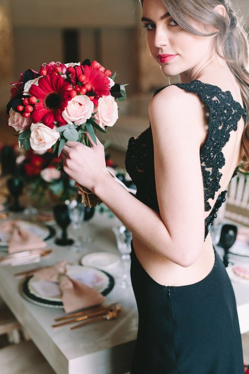Bride in Black Skirt and Lace Top Holding a Pink and Red Bouquet