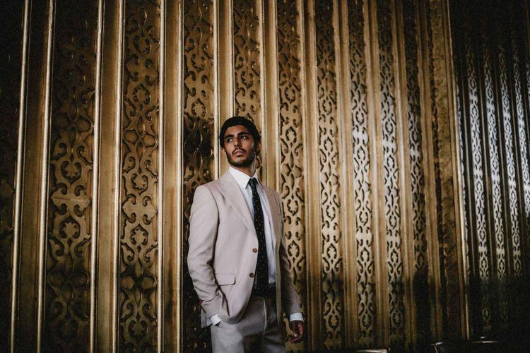 Groom in cream suit for Egypt wedding
