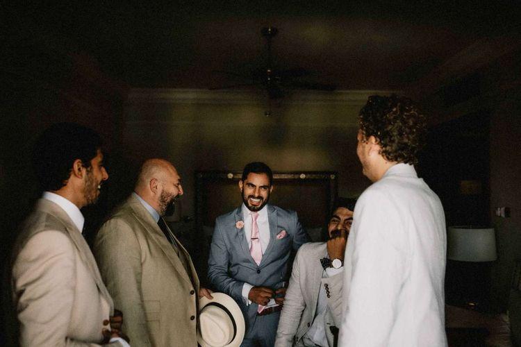 Groom wedding preparations for destination wedding