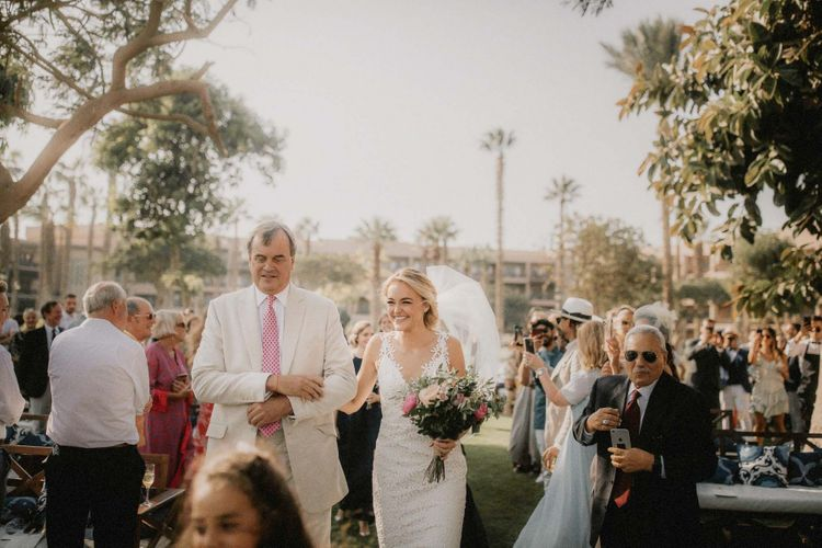 Bride walks down the aisle at destination wedding ceremony