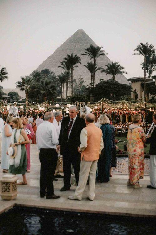 Guests enjoy drinks at destination wedding