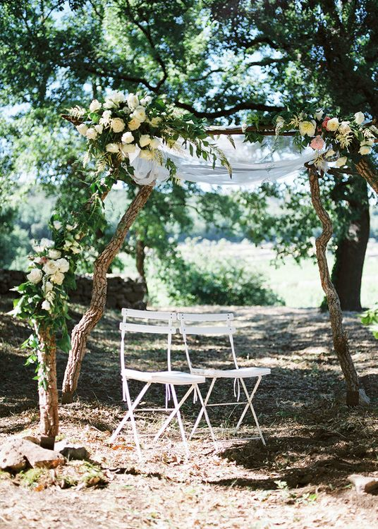 Floral Arch   Outdoor Wedding at Commanderie de Peyrassol, Provence, France Styled by La Chuchoteuse   Lace Bridal Gown   Black Tie Suit   Rustic Stretch Tent Reception   Raisa Zwart Photography
