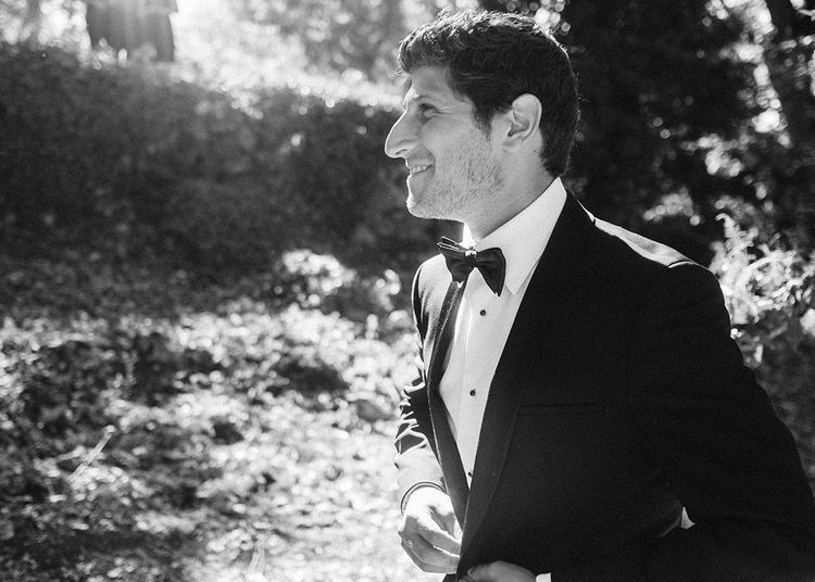 Groom in Tuxedo   Outdoor Wedding at Commanderie de Peyrassol, Provence, France Styled by La Chuchoteuse   Lace Bridal Gown   Black Tie Suit   Rustic Stretch Tent Reception   Raisa Zwart Photography