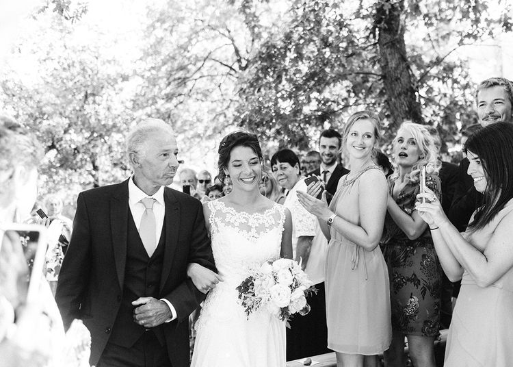Bridal Entrance in Lace Wedding Dress   Outdoor Wedding at Commanderie de Peyrassol, Provence, France Styled by La Chuchoteuse   Lace Bridal Gown   Black Tie Suit   Rustic Stretch Tent Reception   Raisa Zwart Photography
