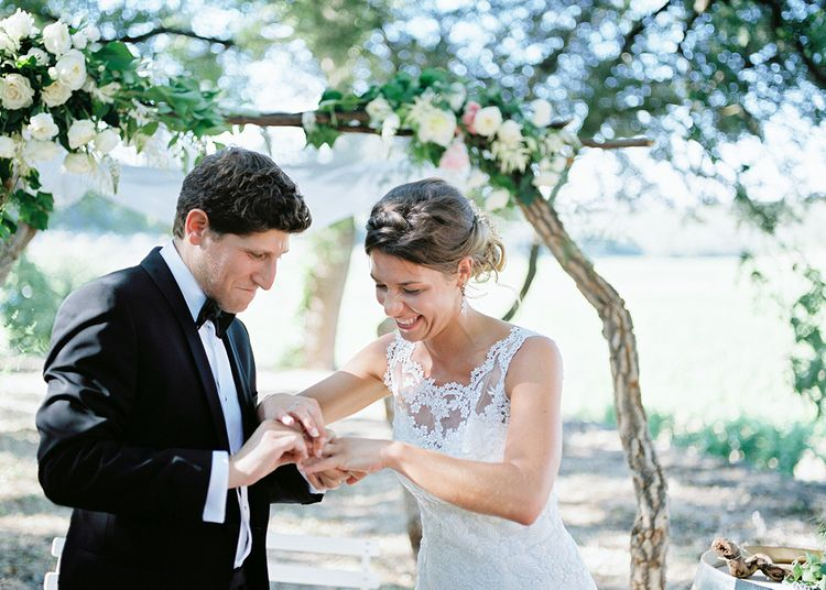Wedding Ceremony   Elegant Bride in Lace Wedding Dress   Groom in Black Tie Suit   Outdoor Wedding at Commanderie de Peyrassol, Provence, France Styled by La Chuchoteuse   Lace Bridal Gown   Black Tie Suit   Rustic Stretch Tent Reception   Raisa Zwart Photography