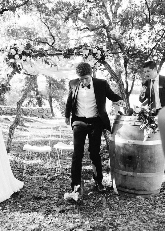 Wedding Ceremony   Groom in Black Tie Suit   Outdoor Wedding at Commanderie de Peyrassol, Provence, France Styled by La Chuchoteuse   Lace Bridal Gown   Black Tie Suit   Rustic Stretch Tent Reception   Raisa Zwart Photography