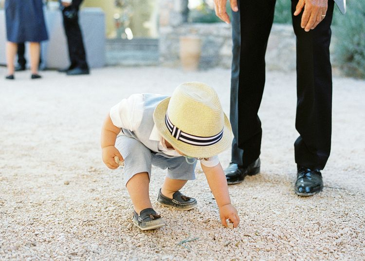 Page Boy in Shorts and Trilby   Outdoor Wedding at Commanderie de Peyrassol, Provence, France Styled by La Chuchoteuse   Lace Bridal Gown   Black Tie Suit   Rustic Stretch Tent Reception   Raisa Zwart Photography