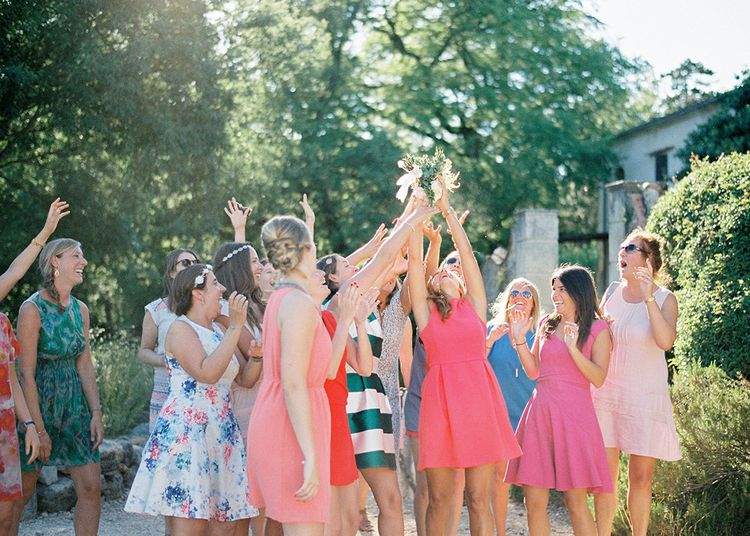 Throwing The Bouquet   Outdoor Wedding at Commanderie de Peyrassol, Provence, France Styled by La Chuchoteuse   Lace Bridal Gown   Black Tie Suit   Rustic Stretch Tent Reception   Raisa Zwart Photography