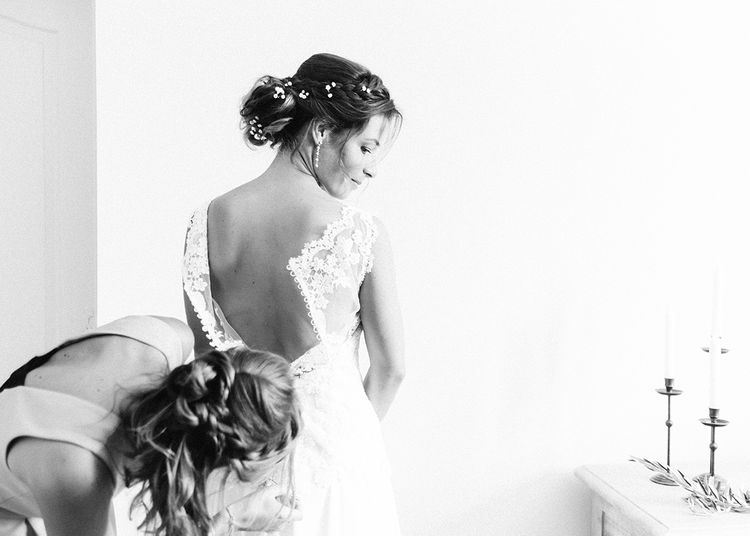 Wedding Morning Bridal Preparations   Elegant Bride in Lace Wedding Dress   Outdoor Wedding at Commanderie de Peyrassol, Provence, France Styled by La Chuchoteuse   Lace Bridal Gown   Black Tie Suit   Rustic Stretch Tent Reception   Raisa Zwart Photography