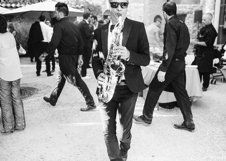 Saxophonist   Outdoor Wedding at Commanderie de Peyrassol, Provence, France Styled by La Chuchoteuse   Lace Bridal Gown   Black Tie Suit   Rustic Stretch Tent Reception   Raisa Zwart Photography