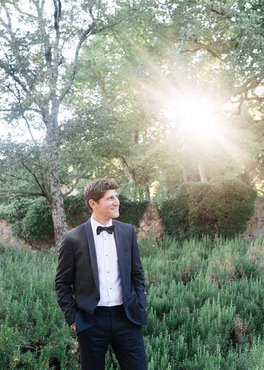 Groom in Tuxedo Suit   Outdoor Wedding at Commanderie de Peyrassol, Provence, France Styled by La Chuchoteuse   Lace Bridal Gown   Black Tie Suit   Rustic Stretch Tent Reception   Raisa Zwart Photography