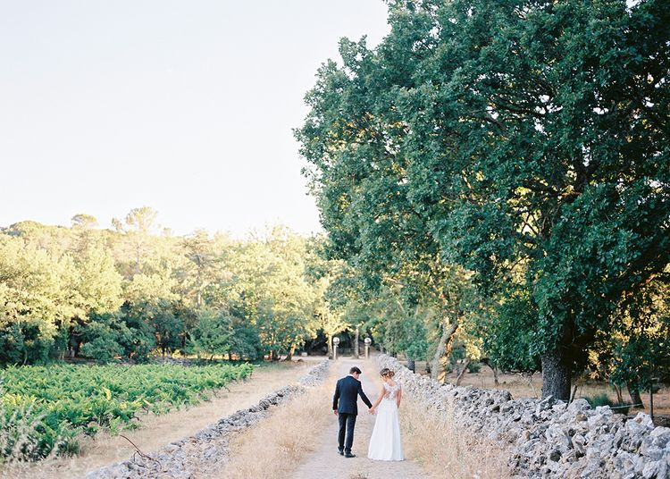 Elegant Bride in Lace Wedding Dress   Groom in Black Tie Suit   Outdoor Wedding at Commanderie de Peyrassol, Provence, France Styled by La Chuchoteuse   Lace Bridal Gown   Black Tie Suit   Rustic Stretch Tent Reception   Raisa Zwart Photography
