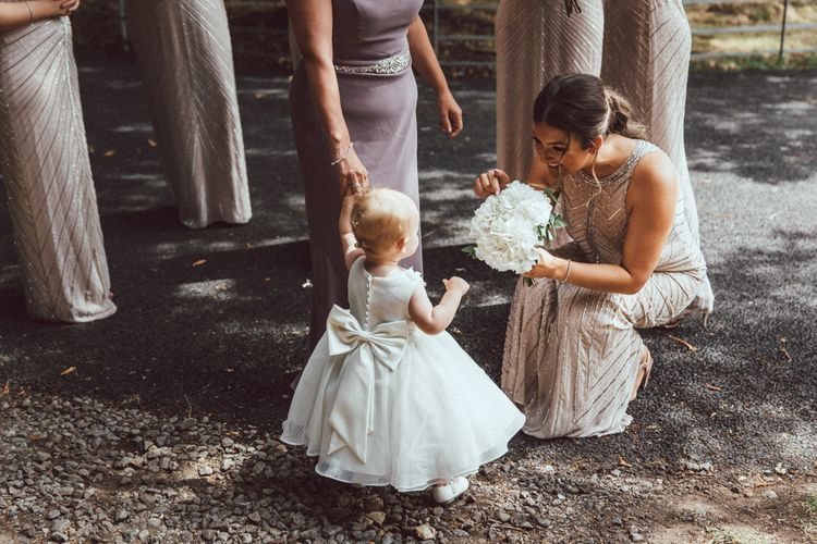 Flower Girl In White Dress With Bow // The Vedrines Photography