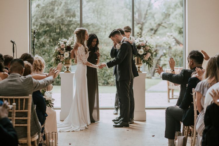 Wedding Ceremony | Personalised Vows | Bride in Madison James Bridal Gown | Groom in Tuxedo | Millbridge Court, Surrey Wedding with DIY Decor, Foliage & Giant Balloons | Nataly J Photography
