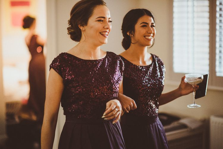 Bridesmaids in Coast Burgundy Separates | Sequin Top & High Low Skirts | Burgundy & Gold Winter Wedding at Ramster Hall Weddings, Surrey | Matt Penberthy Photography | John Harris Wedding Films