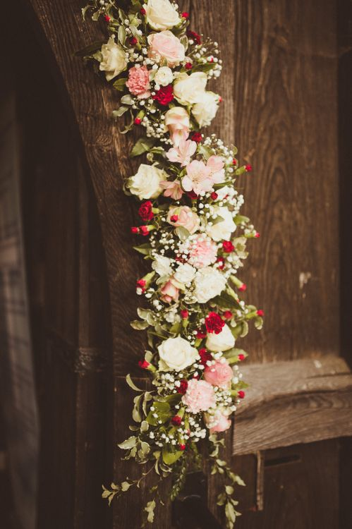 Church Burgundy, Pink & White Floral Arch Flowers | Burgundy & Gold Winter Wedding at Ramster Hall Weddings, Surrey | Matt Penberthy Photography | John Harris Wedding Films