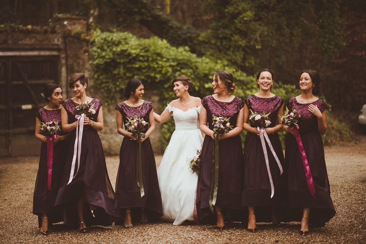Bridesmaids in Coast Burgundy Separates | Sequin Tops & High Low Skirts | Bride in Lillian West Bridal Separates | Burgundy & Gold Winter Wedding at Ramster Hall Weddings, Surrey | Matt Penberthy Photography | John Harris Wedding Films