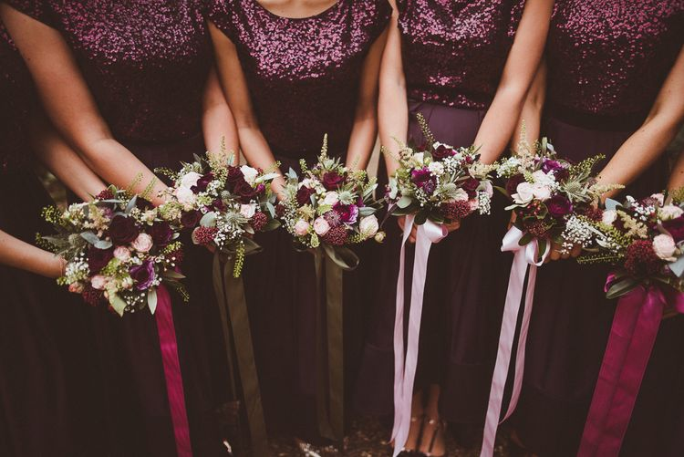 Bouquets with Ribbon | Bridesmaids in Coast Burgundy Separates | Sequin Tops & High Low Skirts | Bride in Lillian West Bridal Separates | Burgundy & Gold Winter Wedding at Ramster Hall Weddings, Surrey | Matt Penberthy Photography | John Harris Wedding Films
