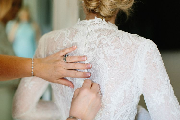 Button detail on dress | Papakata Sperry Tent Wedding at family home | Sassi Holford Dress with added ivory Ostrich feathers to veil | Manolo Blahnik shoes | Images by Melissa Beattie