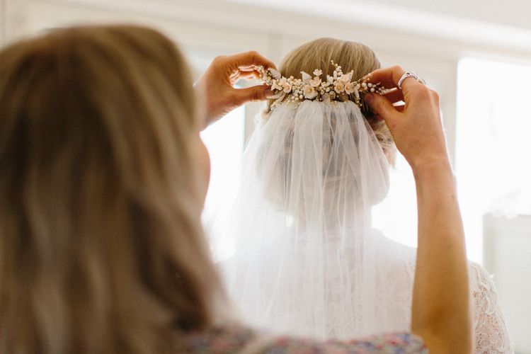 Hair comb and low loose up do for Bride | Papakata Sperry Tent Wedding at family home | Sassi Holford Dress with added ivory Ostrich feathers to veil | Manolo Blahnik shoes | Images by Melissa Beattie