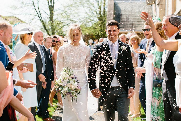 Confetti | Papakata Sperry Tent Wedding at family home | Sassi Holford Dress with added ivory Ostrich feathers to veil | Manolo Blahnik shoes | Images by Melissa Beattie