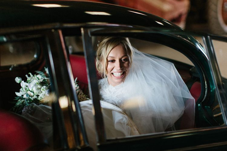 Green classic wedding car | Papakata Sperry Tent Wedding at family home | Sassi Holford Dress with added ivory Ostrich feathers to veil | Manolo Blahnik shoes | Images by Melissa Beattie