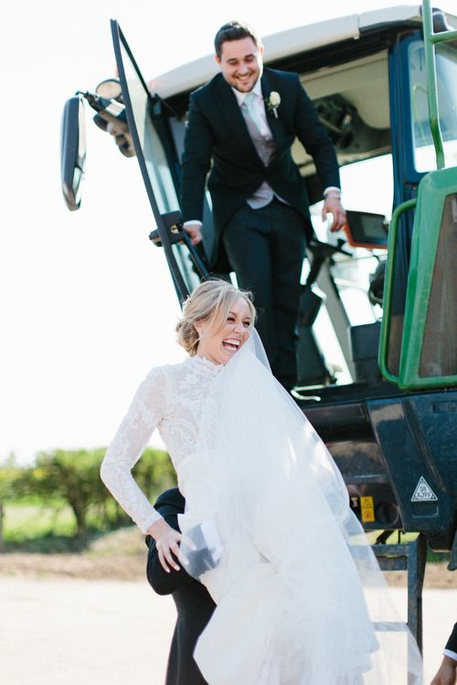 Farm wedding tractor ride | Papakata Sperry Tent Wedding at family home | Sassi Holford Dress with added ivory Ostrich feathers to veil | Manolo Blahnik shoes | Images by Melissa Beattie