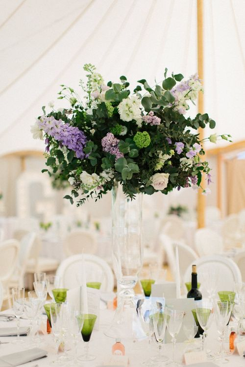 White, green and lilac flowers | Papakata Sperry Tent Wedding at family home | Sassi Holford Dress with added ivory Ostrich feathers to veil | Manolo Blahnik shoes | Images by Melissa Beattie