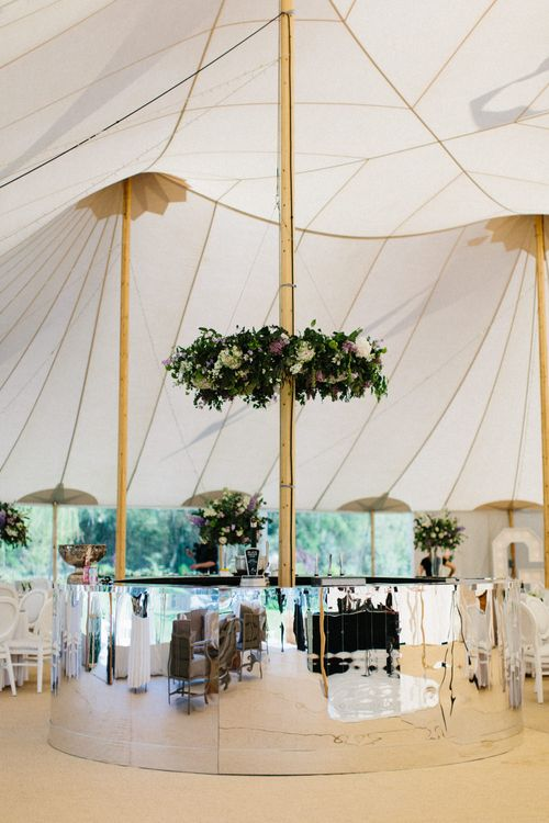 Silver bar and floral wreath | Papakata Sperry Tent Wedding at family home | Sassi Holford Dress with added ivory Ostrich feathers to veil | Manolo Blahnik shoes | Images by Melissa Beattie