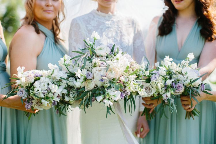 Twobirds Bridesmaid dresses in green | Papakata Sperry Tent Wedding at family home | Sassi Holford Dress with added ivory Ostrich feathers to veil | Manolo Blahnik shoes | Images by Melissa Beattie