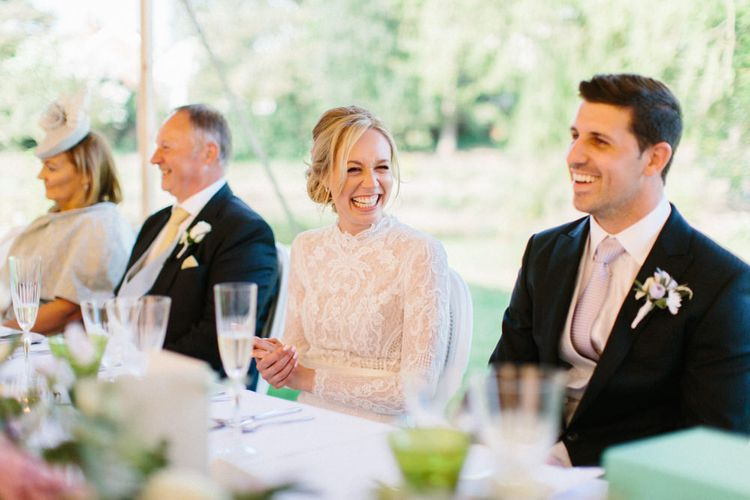 Papakata Sperry Tent Wedding at family home | Sassi Holford Dress with added ivory Ostrich feathers to veil | Manolo Blahnik shoes | Images by Melissa Beattie